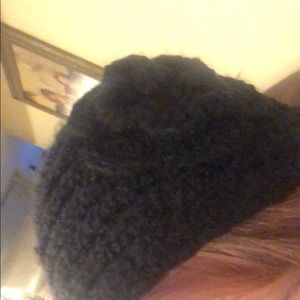 Accessories - Black knit ear warmers with flower detail.